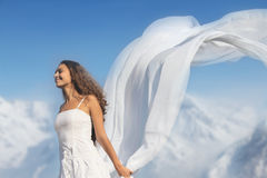 Young woman with fabric in mountains Stock Image
