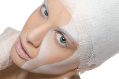 Young woman with face art and bandage Royalty Free Stock Image