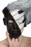 Young  woman with face art and rock gesture Royalty Free Stock Image