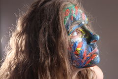 Young woman with face-art Royalty Free Stock Images