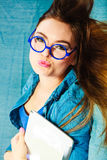 Young woman face in blue glasses Royalty Free Stock Photo
