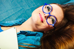 Young woman face in blue glasses. Eyewear. Young attractive woman face in blue glasses, closeup Royalty Free Stock Image