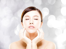 Young  woman face with blur background Stock Images