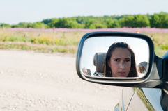 Young woman face in car mirror Royalty Free Stock Photography