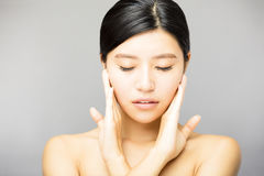 Young  woman face with clean  skin Stock Photo