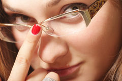Young woman face in eyeglasses Stock Photography