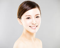 Young  woman face with gray background Stock Images