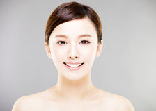 Young  woman face with gray background Royalty Free Stock Image