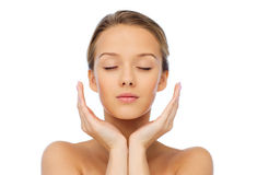 Young woman face and hands Royalty Free Stock Image
