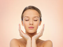 Young woman face and hands Stock Photography