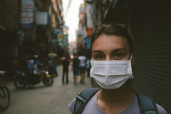 Young woman with face mask. In the streets of Kathmandu Royalty Free Stock Images
