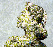 Young woman face over blooming tree pattern Royalty Free Stock Image
