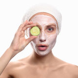 Young woman with a face pack. Stock Photos