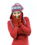 Young woman from face in palms in winter hat Stock Photography