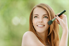 Young woman on face powder Stock Photography