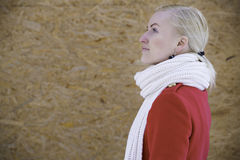 Woman face profile with white woven scarf Stock Image