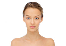 Young woman face and shoulders. Beauty, people and health concept - young woman face and shoulders Royalty Free Stock Image