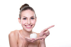 Young woman face show cream Royalty Free Stock Photos