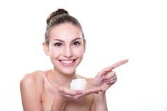 Young woman face show cream Royalty Free Stock Photos