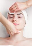 Young woman facial make up removing in beauty Royalty Free Stock Images