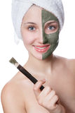 Young woman with facial mask in beauty spa. Royalty Free Stock Photography