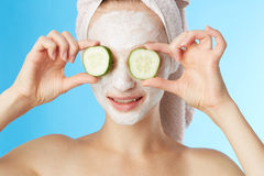 Young woman with facial mask Royalty Free Stock Images