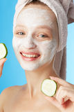 Young woman with facial mask Royalty Free Stock Image