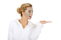 Young woman with facial mask holding something on her hand Stock Photos