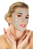 Young  woman with facial mask. Isolated on white Stock Images