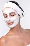 Young woman with facial mask smiling Royalty Free Stock Photo