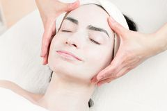 Young woman facial massage in beauty parlour Stock Image