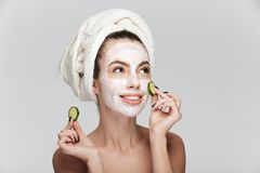 young woman with facial skincare mask and cucumber slices stock photography