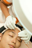 Young Woman at Facial Treatment Stock Photos