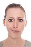 Young woman facing bipolar disorders, happy and sadly, two faces. Isolated royalty free stock photography