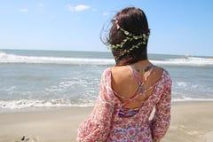 Young woman facing the sea Stock Photo