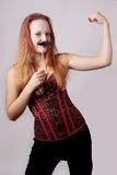 Young woman with fake moustache Stock Photography