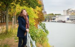 Young woman on a fall day in Paris Royalty Free Stock Images