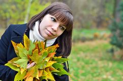 Young woman with fall leaves royalty free stock image