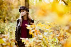 Young woman at fall stock photography