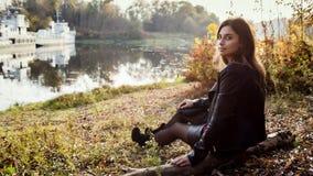 Young woman at fall stock image