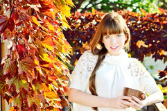 Young woman in fall time Stock Photos