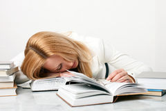 Young woman falling asleep while studying Royalty Free Stock Photo