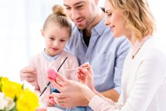 Young woman with family painting stock photo