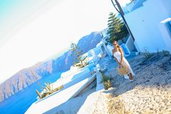 Young woman in famous capital Fira of Santorini Stock Photography