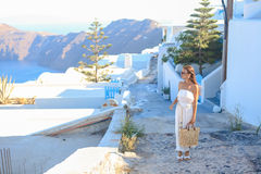 Young woman in famous capital Fira of Santorini Royalty Free Stock Images
