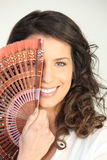 Young woman with a fan Stock Image