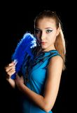 Young woman with fan. Portrait of a beautiful young woman with a blue fan Royalty Free Stock Image