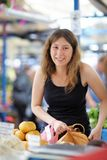 Young woman at the farmer market Royalty Free Stock Image