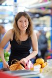 Young woman at the farmer market Royalty Free Stock Images