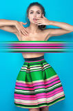 Young woman in fashion clothes in studio Stock Photo